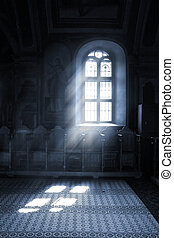 Seeing the light, - Shafts of light stream through stained...