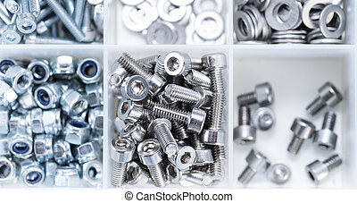 Screws and Machine Parts in a box - Screws and some other...