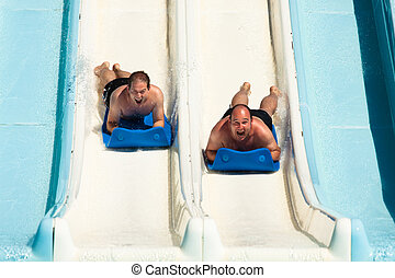 People at water park - People having fun, sliding at water...