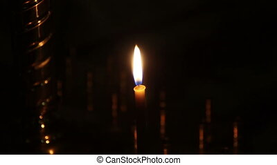 orange candle burn in the church