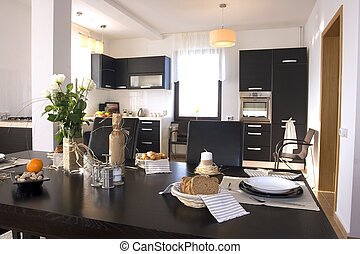 Dining room table set with kitchen on background