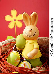 Colorful Easter eggs and a bunny with a flower