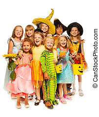 Many kids stand in Halloween costumes together - Big group...