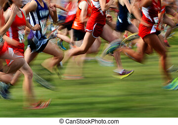Running a Race in Motion - Runners running a race with fast...