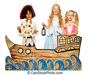 Three kids, pirate and princess on cardboard ship -...