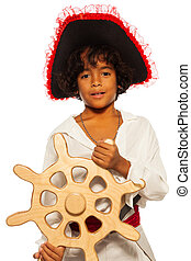 Playing pirate with ship steering wheel - Asian boy in...