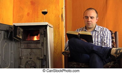 man read book wine stove - young man read book very...