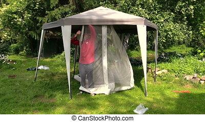 Man attach bower net - Man attach protective tent bower net...