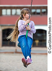 Girl on zip line - Girl taking a ride on zip line with house...