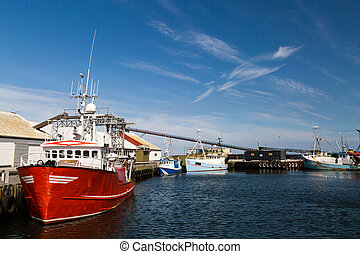 Old fishing trawler moored in the port while waiting for...