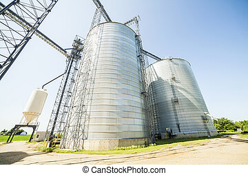 Silver, shiny agricultural silos - Huge, silver, shiny...