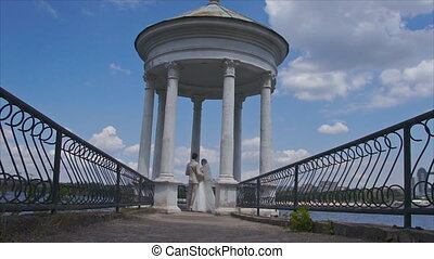 newlyweds are in the gazebo - The newlyweds are in the...