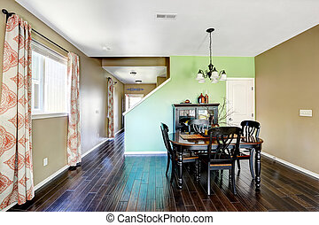 Dining room with beige and green color walls