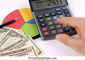 Financial report - Finger pressing on a calculator to...