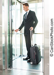 Businesswoman in elevator. Full length of confident young...