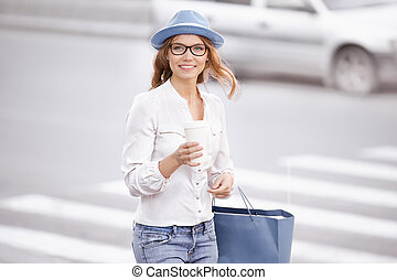 At the crosswalk. - Beautiful young woman standing at the...