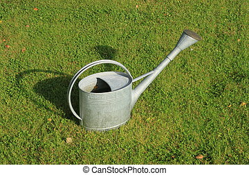 Watering-can (watering-pot) on the grass