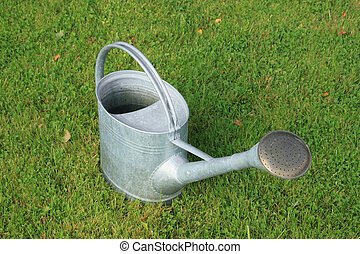 Watering-can watering-pot on the grass