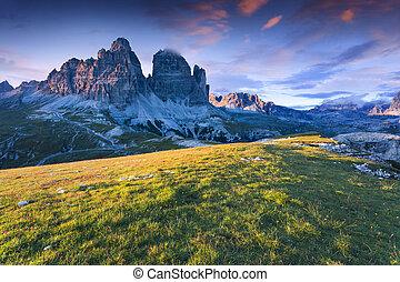 Colorful summer sunrise in Italy Alps, Tre Cime Di Lavaredo,...