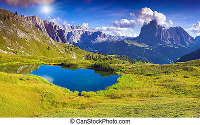 Sassolungo mountain range at sunny summer day. Dolomites...