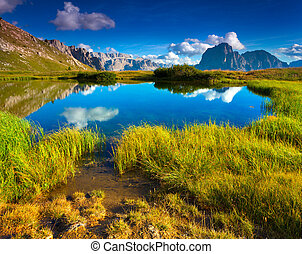 Sassolungo mountain range at sunny summer day. Dolomites...