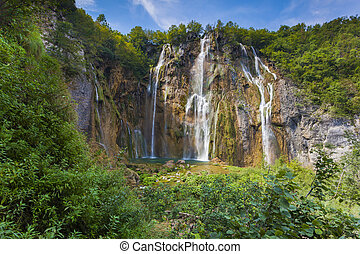 Landscape of a beautiful rock with a waterfall under the...
