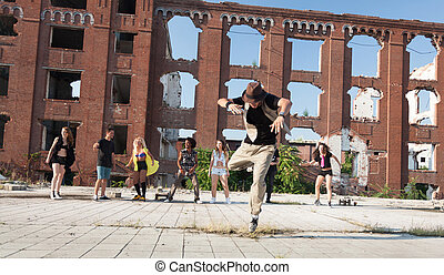 Energetic young hip hop street dancer performing his routine...