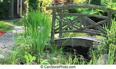 Garden Landscape with bridge - Garden footpath running to...