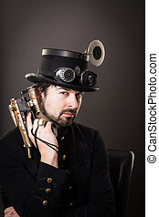 hand gun - armed man in steampunk outfit holding a gun in...