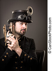 holding gun - armed man in steampunk outfit holding a gun in...