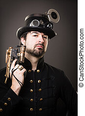 armed man in steampunk outfit holding a gun in his hand
