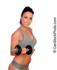 Brunette girl stimulating their fitness with dumbells...