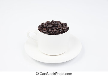 Coffee cup with coffee beans on white isolated background