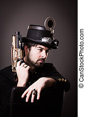 Armed steam punk man - armed man in steampunk outfit holding...
