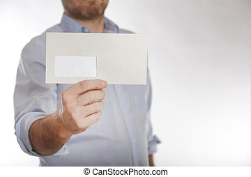 Man holds a letter into the camera - Man in a blue shirt...