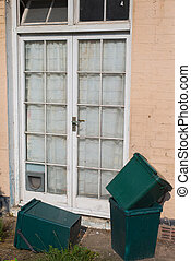 Net Curtains and Rubbish Bins