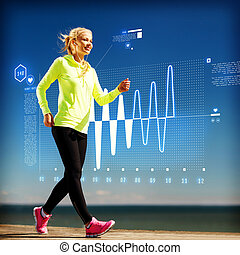 smiling woman doing sports outdoors with earphones -...