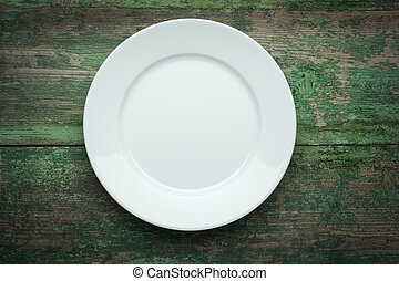Empty white plate on wooden background - Empty white plate...