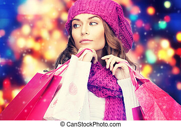 woman in winter clothes with pink shopping bags - shopping,...