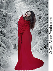 Woman in red dress in snow. Fantasy woman, book cover
