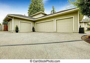 Three car garage with driveway. House exterior