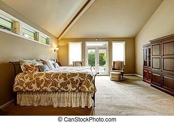 Luxury house interior. Bedroom with high vaulted ceiling and...