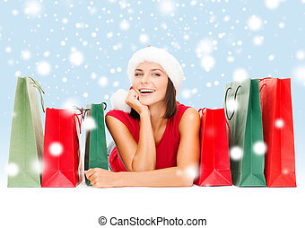 woman in red shirt with shopping bags - sale, gifts,...