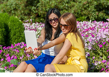 Having fun together Two beautiful young women making selfie...