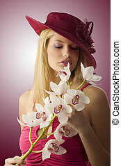 red hat anf flowers - beautiful young woman with red hat and...
