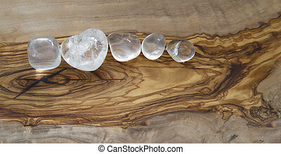 Clear crystals on olive wood - Clear quartz tumbled gem...
