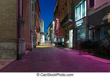Street in the old town at night in Italy