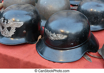 old German military helmets at a flea market in Italy