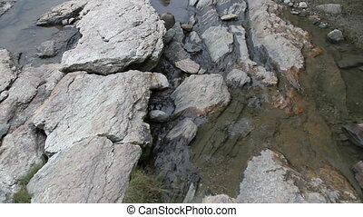 Water trickling down a rock five - Water trickling down a...