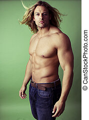 athletic sexy male body builder with the blonde long hair